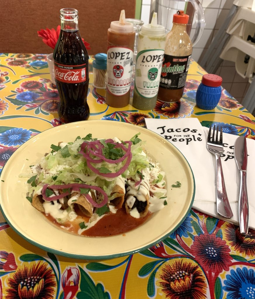 Photo of lunch at Taqueira Lopez y Lopez. Vegetarian flautas and a Coke zero.